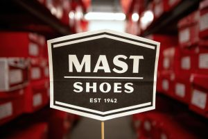 Vintage sign in storage in the upper level of Mast Shoes in Ann Arbor.