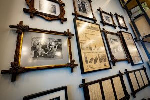 Many historic photos and press clippings highlighting the store's rich history are displayed near the entrance of the Mast Shoe Store showroom in Ann Arbor.